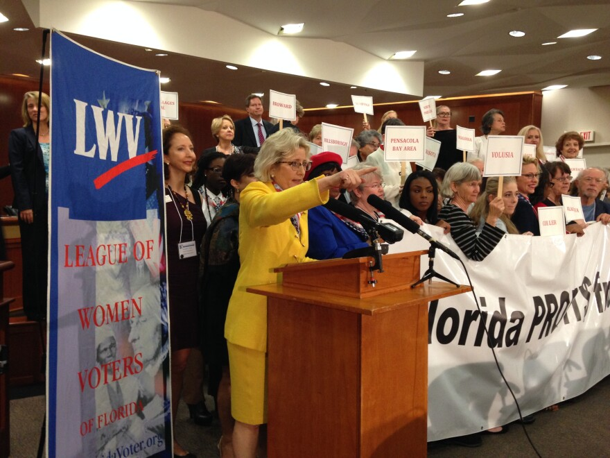 Deirdre Macnab and healthcare advocates with the League of Women Voters of Florida, rally in the Capitol's Cabinet Room on Wednesday.