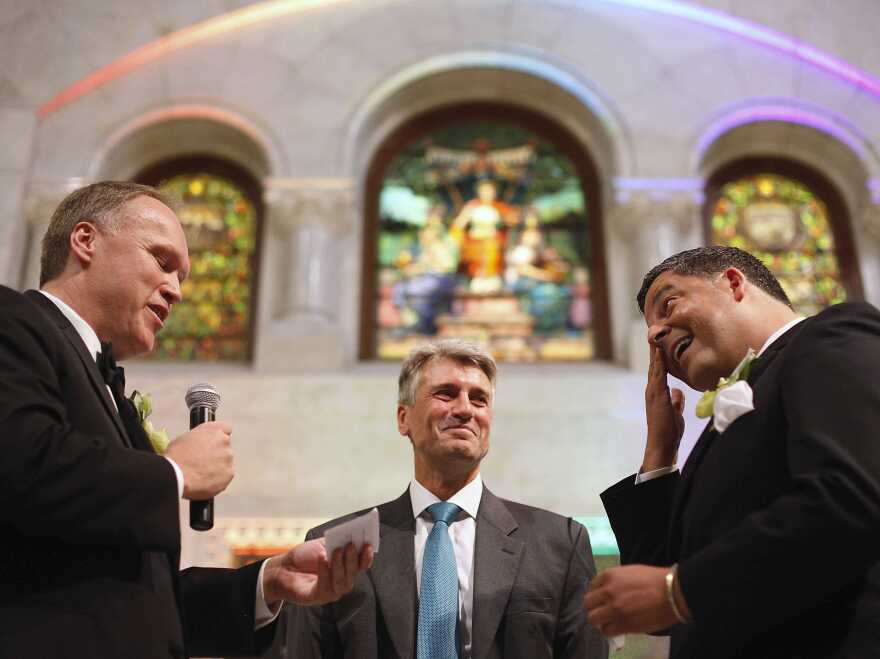 """Minneapolis Mayor R.T. Rybak officiates at the wedding of Al Giraud, right, and his partner Jeff Isaacson at the Minneapolis City Hall on Aug. 1. Rybak is now on the road launching a """"Marry in Minneapolis"""" campaign."""