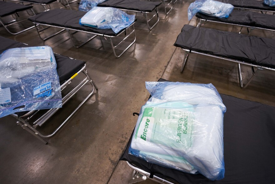 Cots are staged for setup as Texas Army National Guardsmen set up a field hospital in response to the new coronavirus crisis at the Kay Bailey Hutchison Convention Center on March 31, 2020, in Dallas.