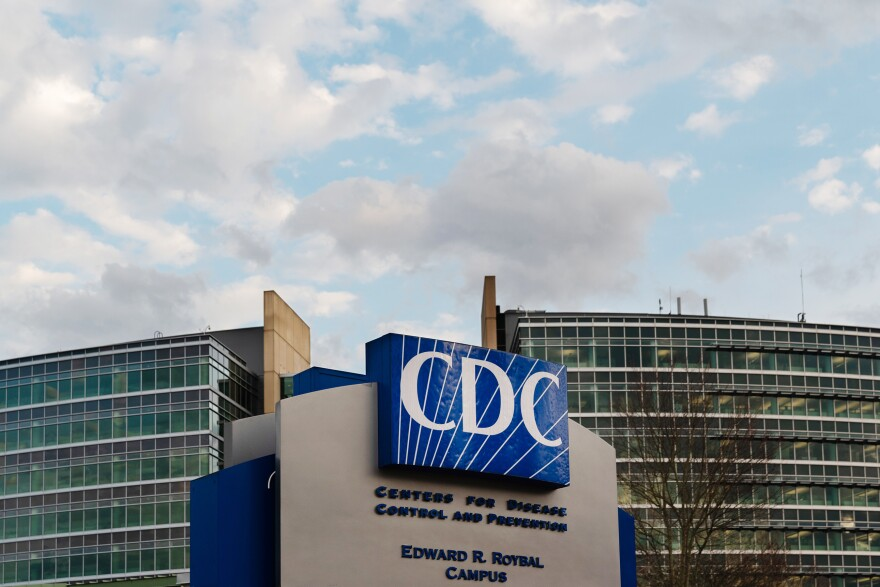 The Centers for Disease Control and Prevention (CDC) headquarters stands in Atlanta. CDC director Dr. Robert Redfield says the agency will double the current number of positions to aid local health departments in quashing new outbreaks.