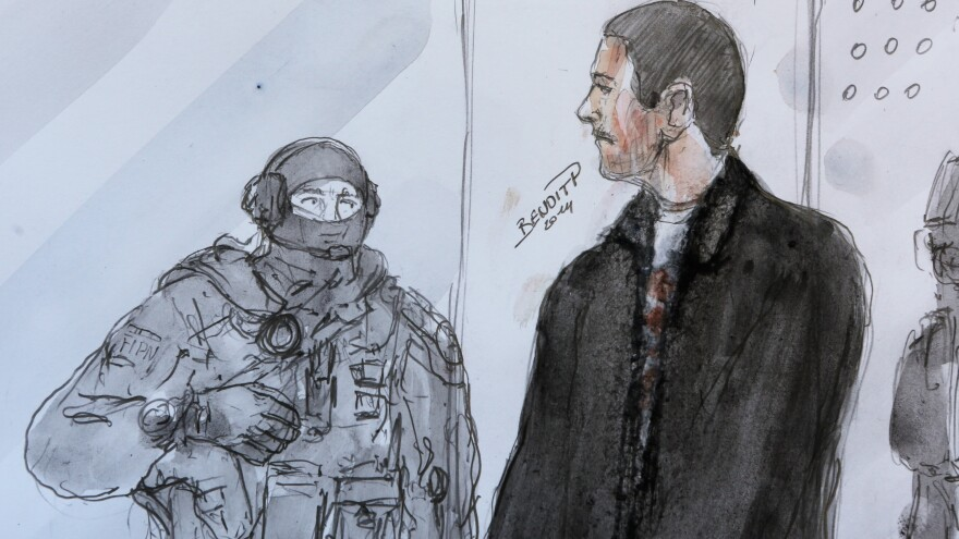 French citizen Mehdi Nemmouche, seen here at right in a courtroom drawing, has been identified by a former hostage of the Islamic State as one of the group's jailers. Nemmouche is accused of attacking a Jewish museum in Belgium.