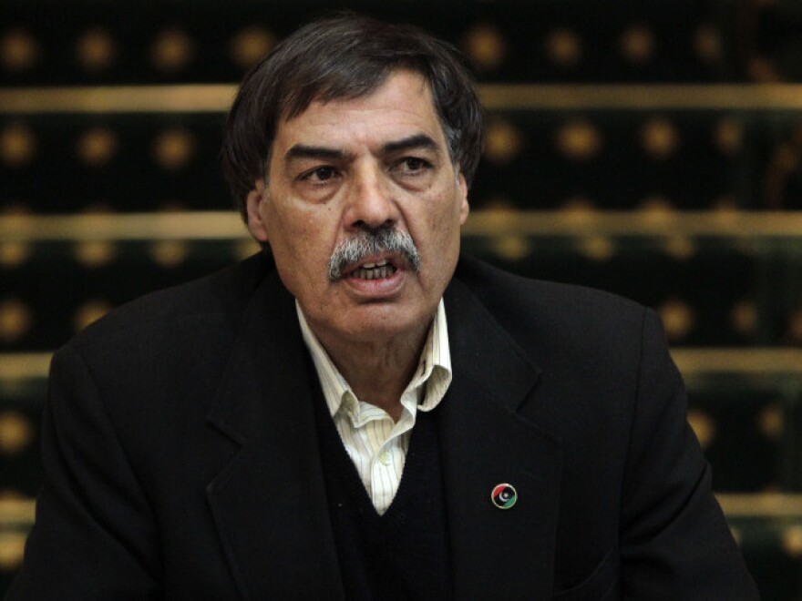 Ali Tarhouni, who is finance and oil minister for the Libyan opposition's National Transitional Council, speaks to the media in Benghazi on April 1. Tarhouni spoke to NPR on Thursday about his daring clandestine trip to bring money and moral support to the besieged city of Misrata.