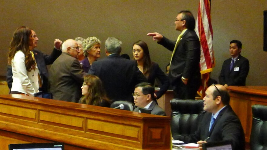 Republican and Democratic leaders in the Hawaii House discuss how to proceed with a vote to remove Rep. Beth Fukumoto (center right) as minority leader Wednesday. Once a rising star in her party, Fukumoto says she's asking constituents if she should switch parties.