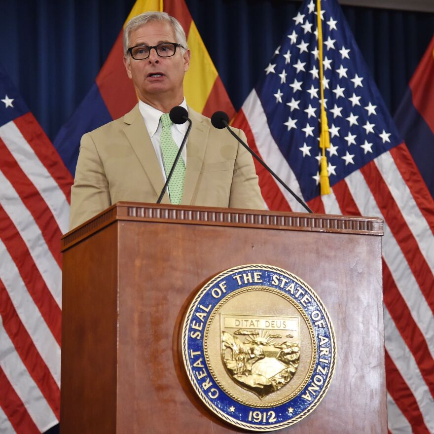 Rick Davis, spokesman for the family of Sen. John McCain, speaks to the media during a news conference at the Arizona State Capitol Executive Tower in Phoenix on Sunday. Davis discussed memorial arrangements planned for McCain and read a final letter from the two-time presidential candidate and war hero.