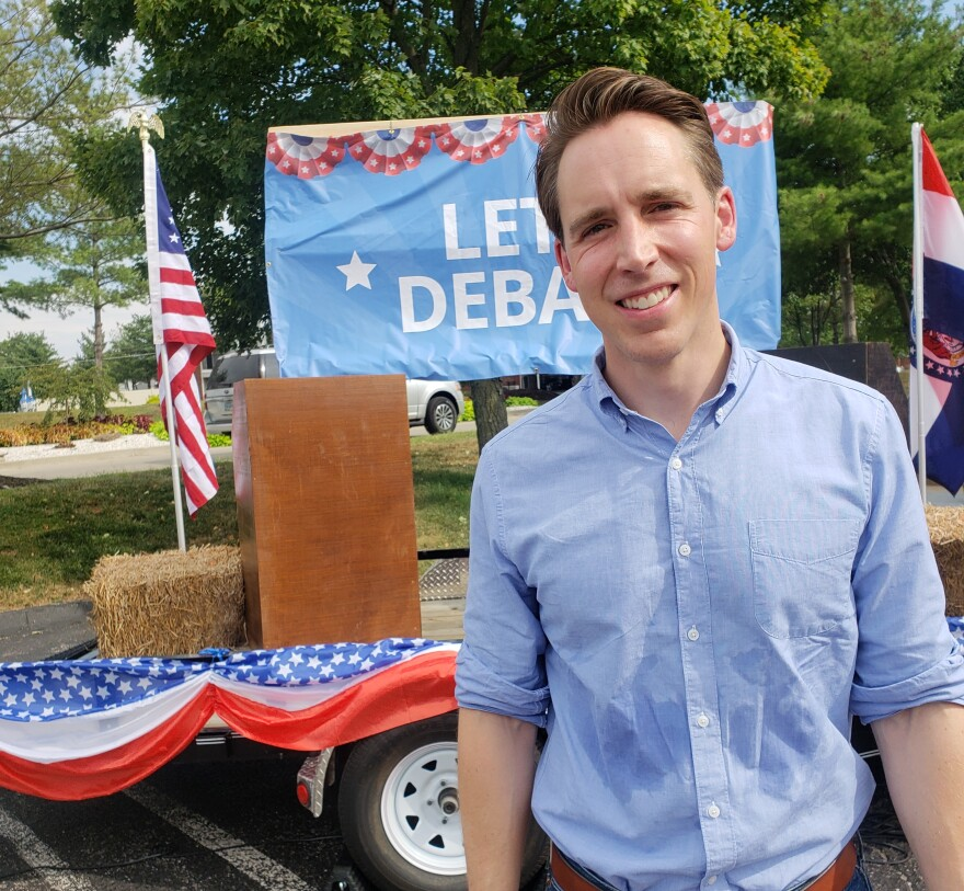 Hawley stands in front of his traveling debate trailer, parked Wednesday in St. Charles.