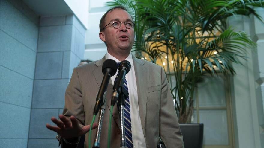 White House Budget Director Mick Mulvaney speaks to media members after a House Republican Conference meeting in September. President Trump selected Mulvaney to lead the Consumer Financial Protection Bureau, a move Democrats say violates the law.