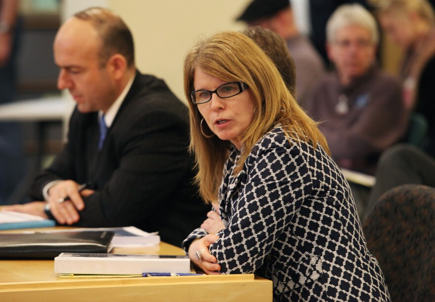Mary Mayhew, commissioner of the Maine Department of Health and Human Services, right, joined by Gary Alexander, a consultant hired by the LePage administration, appears before the Health and Human Services Committee Tuesday Jan. 14, 2014 in Augusta, Maine.