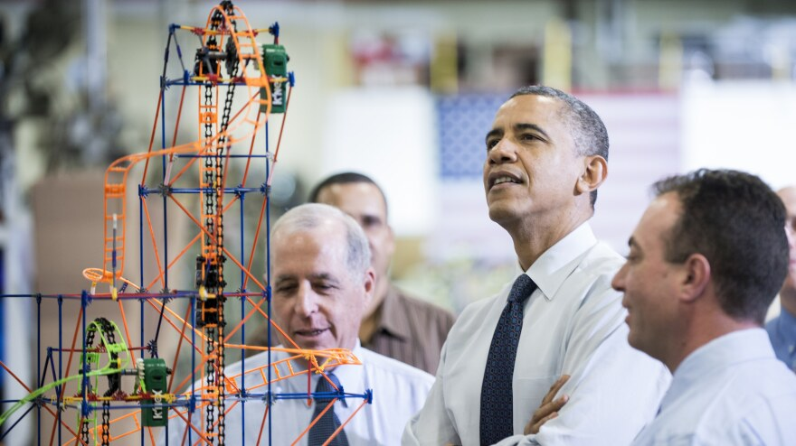 President Obama examines a K'NEX roller coaster on Nov. 30 at a Hatfield, Pa., factory that makes the toys. During the visit, Obama spoke about the economy, the middle class and his plan to raise taxes on top wage earners.