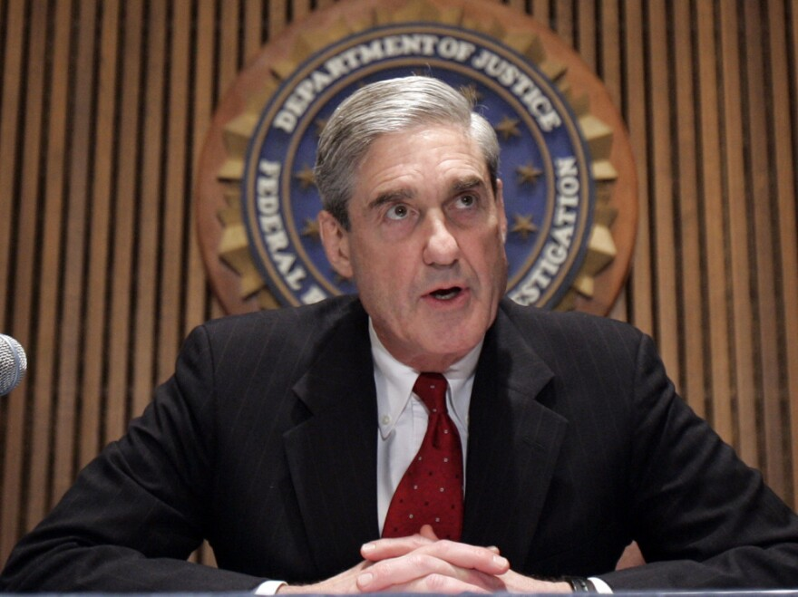 The office of Justice Department special counsel Robert Mueller says 13 Russians and three Russian entities took part in a broad information war against the United States.