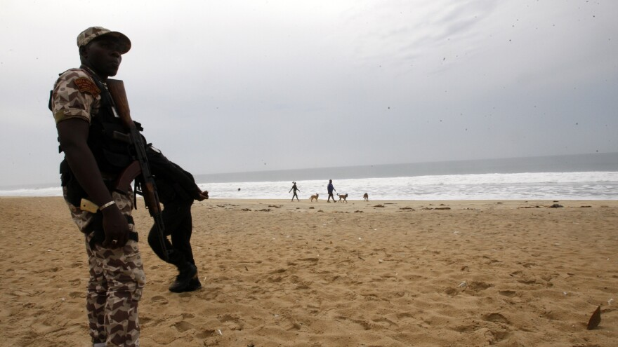 An Ivorian soldier stands guard on March 18, 2016 at the site of a jihadist shooting rampage at the beach resort of Grand Bassam.