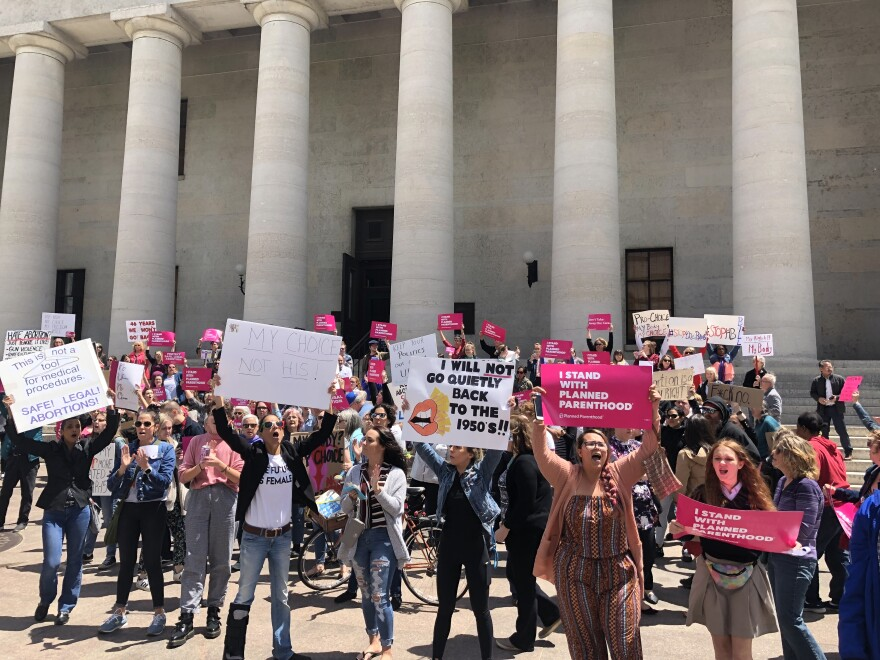 a photo of abortion supporters in front of the statehouse