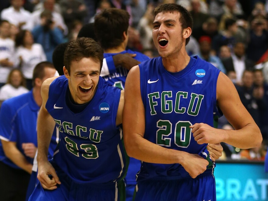 Florida Gulf Coast players Eddie Murray (No. 23) and Chase Fieler (No. 20) celebrate their win Sunday over San Diego State. The game was played at the  Wells Fargo Center in Philadelphia.