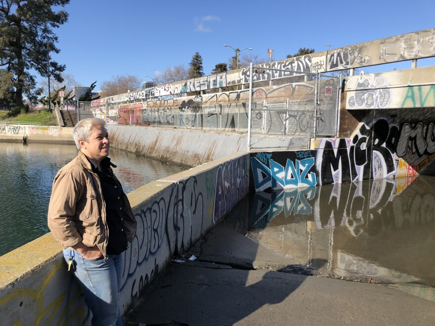 UC Berkeley environmental planner Kristina Hill at a flooded Oakland underpass.