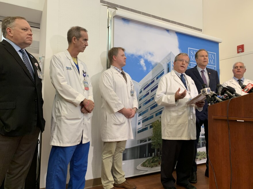 Sarasota Memorial Hospital chief medical officer James Fiorica addresses a press conference Tuesday, with Congressman Vern Buchanan to his right