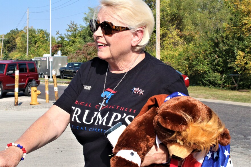 Marian Stevens shows her support for President Donald Trump at an Oct. 7 rally in Overland Park, Kansas, for U.S. Senate candidate Roger Marshall and other Republicans. (Photo by Jim McLean, Kansas News Service)