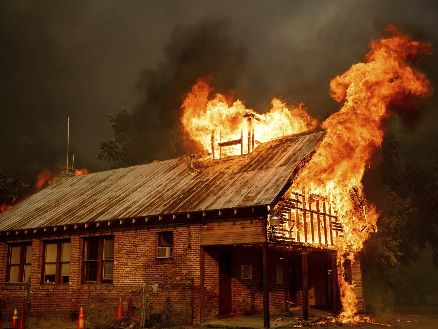 A historic schoolhouse burns as the Carr Fire tears through Shasta, Calif., on Thursday, fueled by high temperatures, wind and low humidity.