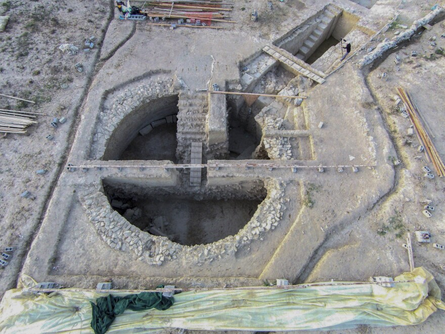 An aerial view of a 3,500-year-old tomb discovered near the southwestern Greek town of Pylos. Recovered grave goods included a golden seal ring and a golden Egyptian amulet.