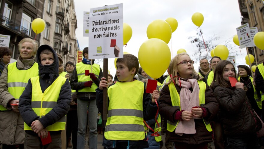 Protesters in Brussels, Belgium, march on Feb. 2 against a proposed law that would allow terminally ill kids to choose euthanasia.