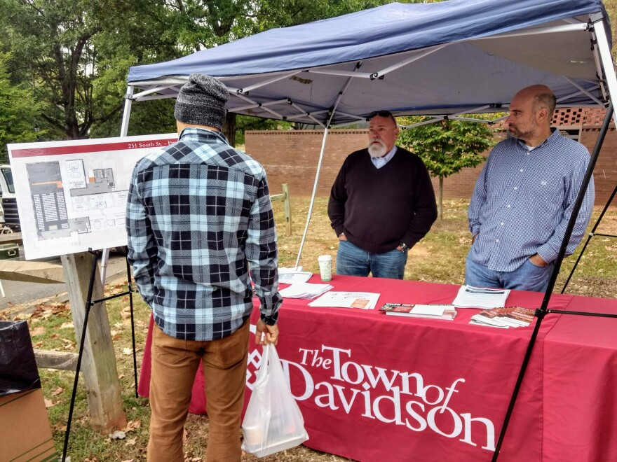 Davidson Mayor Rusty Knox and town manager Jamie Justice talked to voters about the $14 million public facilities bond and sale of Continuum cable and internet company, both on Davidson's 2019 election ballot. (David Boraks photo)