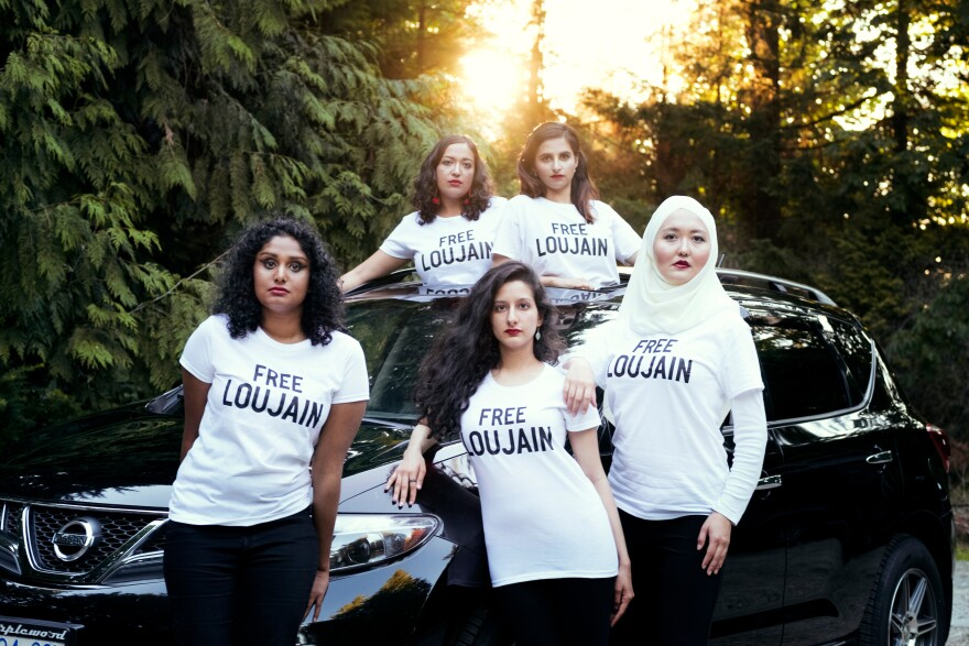 """Friends of Loujain al-Hathloul made a photo to parody a <em>Vogue </em>Arabia cover image showing a Saudi princess in a red convertible. Pictured here (left to right) are Ayendri Ishani Ridell, Urooba Jamal, Narissa Diwan, Atiya Jaffar and Rauza Khan. Hathloul """"took a huge risk to advance women's rights in her country,"""" Jamal says, """"and now is facing the most heinous injustices."""""""