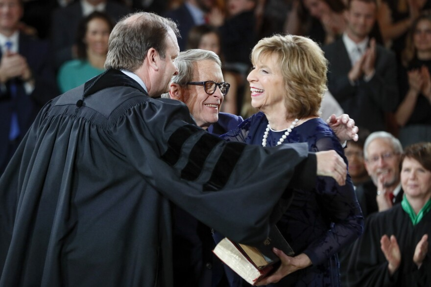 The DeWine's do a group hug after the oath of office.