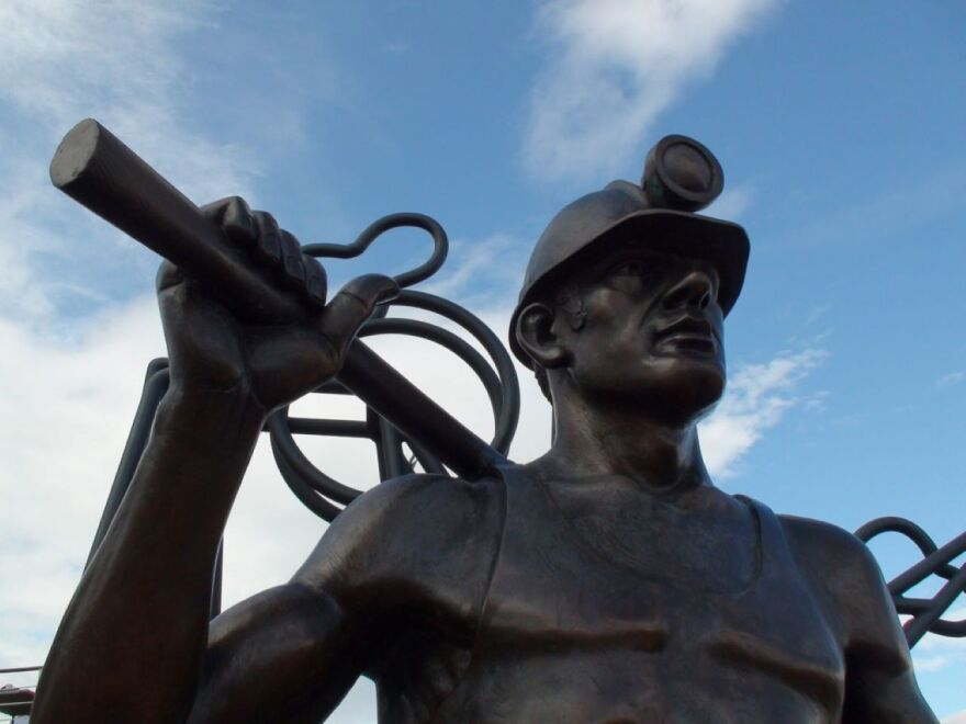 A statue of a miner