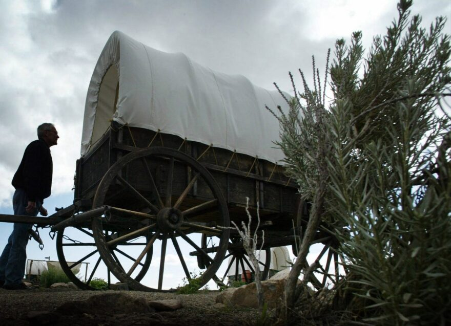 Loren Case, of Boise, Idaho., looks at a life-size wagon replica at the Oregon Trail Interpretive Center located on the Oregon Trail, June 11, 2004, near Baker City, Ore.  (Rick Bowmer/AP)