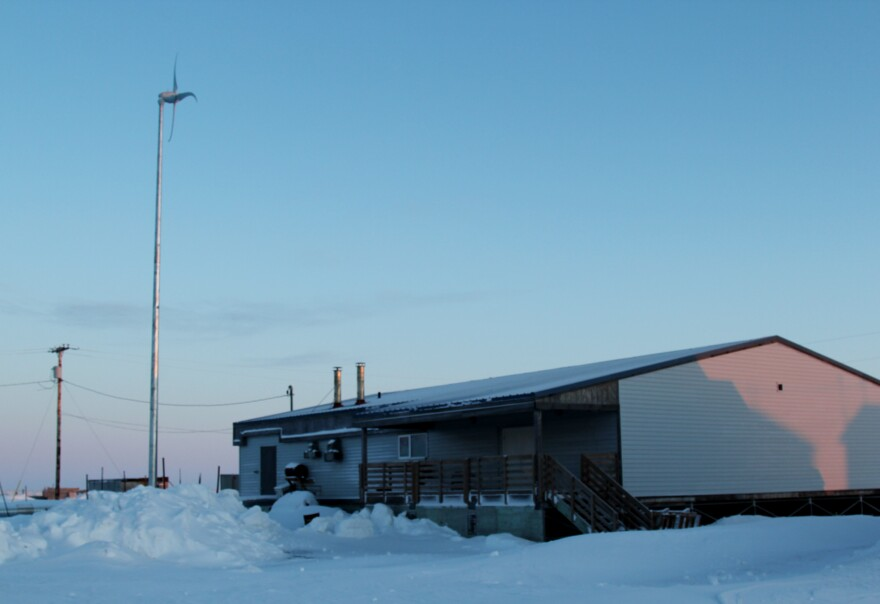 Shishmaref Tannery from the outside. A small wind turbine beside it adds supplemental power, which slightly lessens the high fuel costs of keeping the building warm during the short three-month season it is operating.