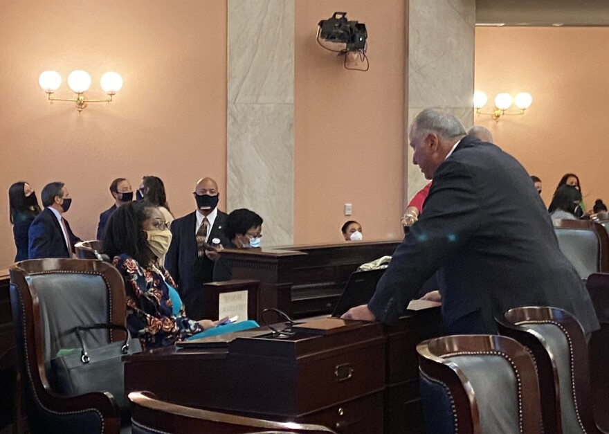 Minority Leader Emilia Sykes (D-Akron) and Speaker Larry Householder (R-Glenford) talk before House session on June 4, 2020, as protestors demonstrate outside the Statehouse. A few moments later, the House held a moment of silence for George Floyd.