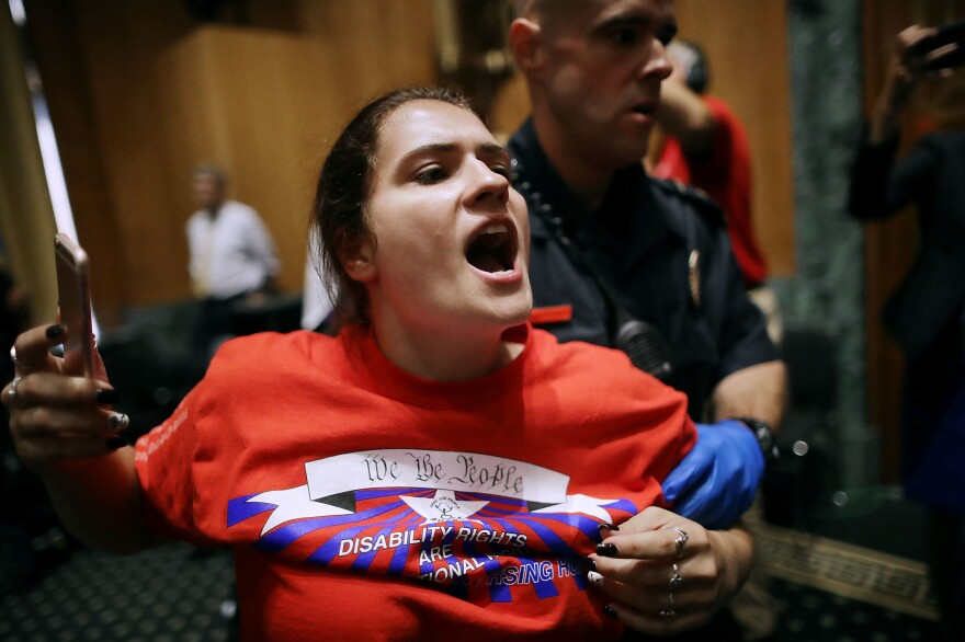 U.S. Capitol Police arrest protesters who disrupted a Senate Finance Committee hearing about a health care proposal to replace Obamacare on Capitol Hill on Sept. 25, 2017.