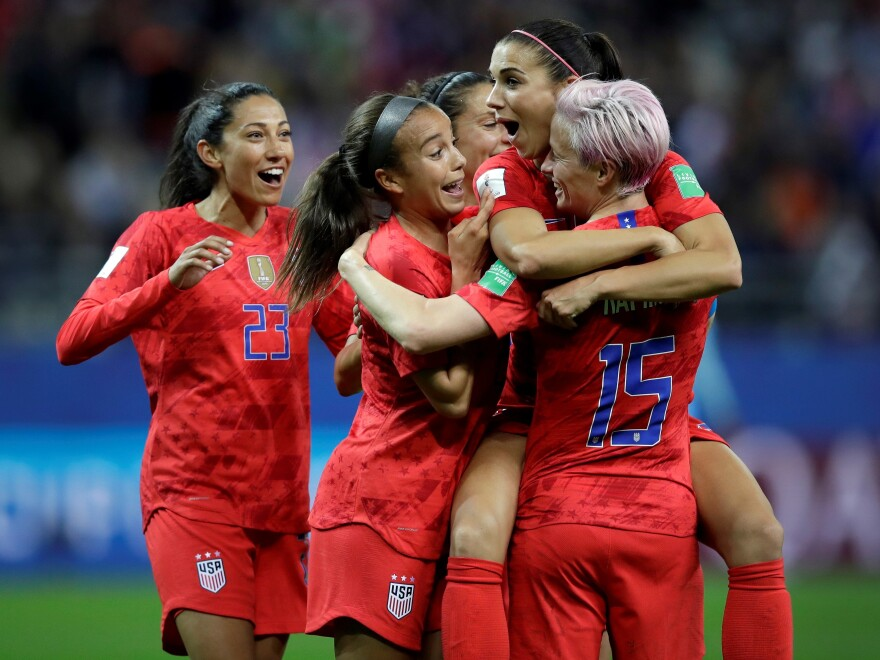 United States' Alex Morgan, second right, celebrates after scoring her side's 12th goal during the Women's World Cup Group F soccer match between United States and Thailand at the Stade Auguste-Delaune in Reims, France on Tuesday.