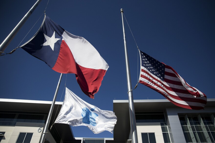 Flags wave outside the Apple campus in North Austin last week.