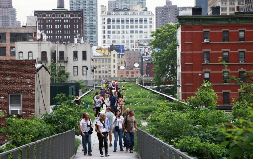 Pedestrians stroll on New York's High Line, a public park that has been constructed on the remains of an abandoned elevated railroad in Manhattan.