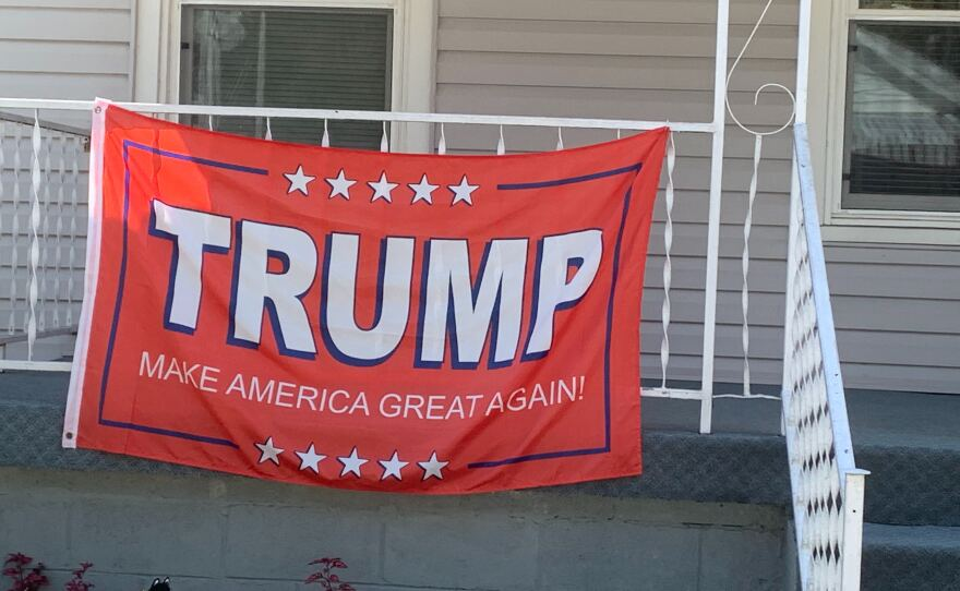 A red flag supporting President Donald Trump hangs on the front porch of a home in southern West Virginia just days before the 2020 election.