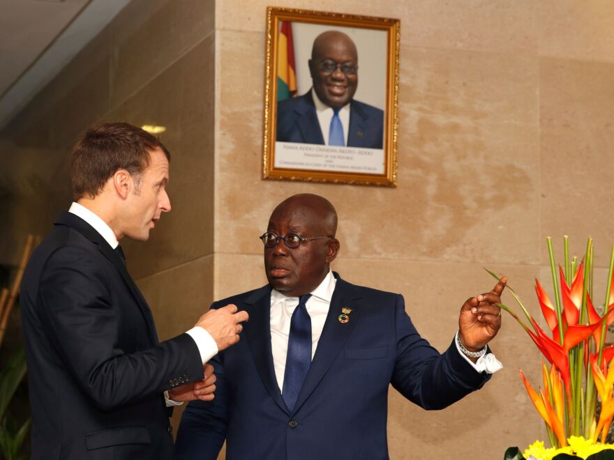 Ghanaian President Nana Akufo-Addo speaks with French President Emmanuel Macron at the presidential palace in Accra.