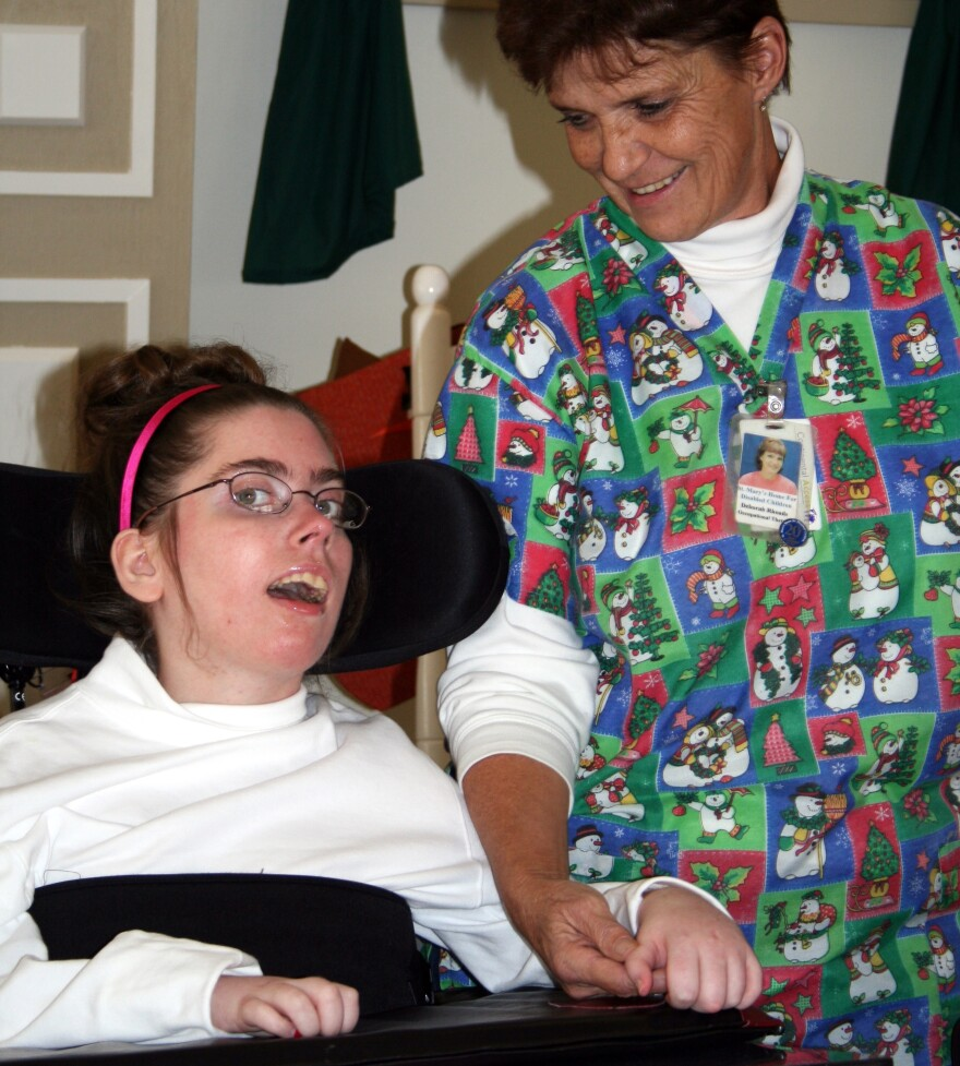 A nurse and patient at St. Mary's Home for Disabled Children