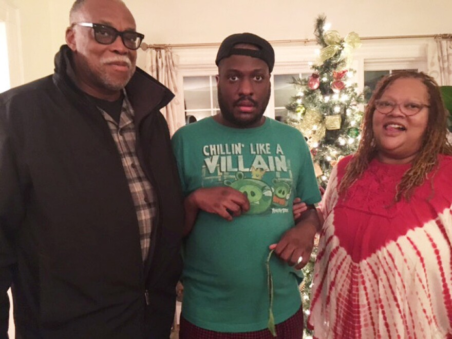 Ronald Hampton, his son Quintin and wife Quintina Hampton pose for a family picture.