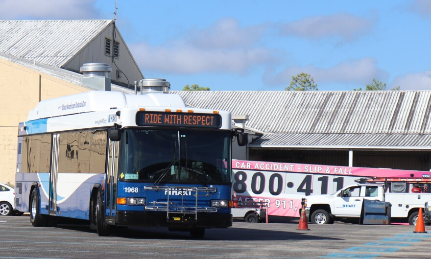 "HART bus with ""Ride with Respect"" on marquee."