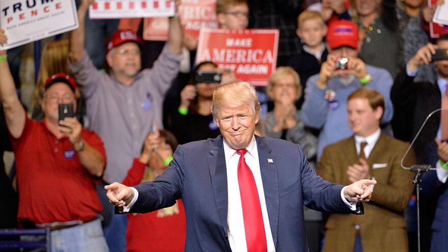 """President-elect Donald Trump points to his supporters during his """"Thank You"""" rally earlier this month in North Carolina."""