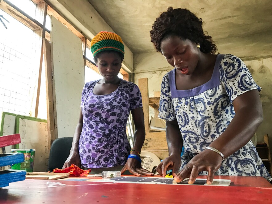 "Judith Ausah (left) and Evelyn Sewodey create solar panels at the Lady Volta Vocational Center for Electricity and Solar Power in Ghana. ""At first, I thought it was man's work,"" says Ausah, whose 2-month-old daughter stays in the school nursery. ""But I came here and saw that, yes, women can do it."""