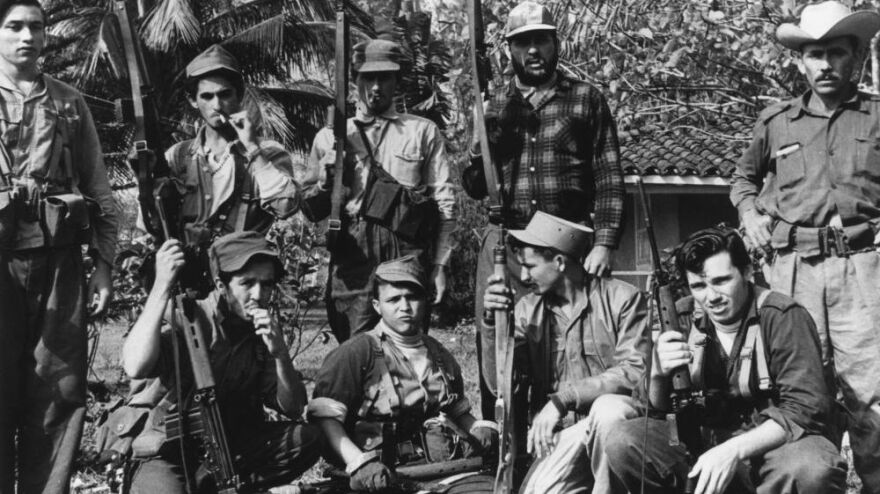 Members of Fidel Castro's militia gather in Cuba's Escambry Mountains during the ill-fated 1961 Bay of Pigs invasion.
