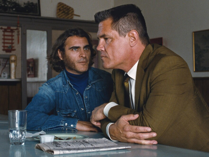 """In <em>Inherent Vice,</em> Joaquin Phoenix (left) plays a burned-out hippie private eye, while Josh Brolin is a Los Angeles Police Department detective --€"""" Lt. Detective """"Bigfoot"""" Bjornsen --€"""" who is investigating a murder and kidnapping case."""