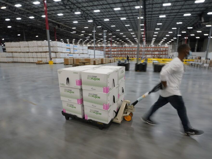 Boxes containing the Moderna COVID-19 vaccine are prepared to be shipped at the McKesson distribution center in Olive Branch, Mississippi. The vaccine campaign needs further federal support, experts say, to speed the effort.