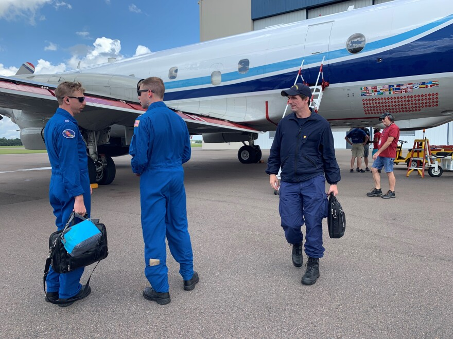 A crew gets off a Hurricane Hunter plane Friday afternoon after an 8-hour flight into Dorian. A few hours later that same plane headed back toward the storm with a different crew.