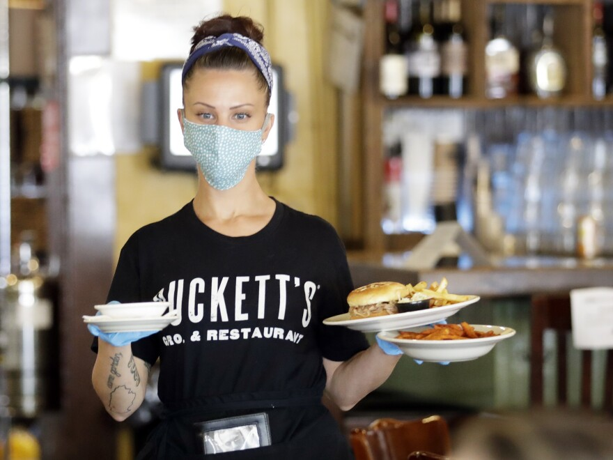 Janis Varela serves customers at Puckett's Grocery & Restaurant on Monday in Franklin, Tenn.