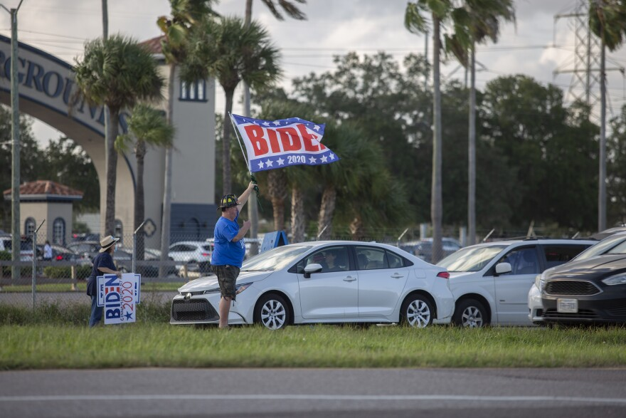 Joe Biden supporters gather during a rally at the Florida State Fairgrounds.