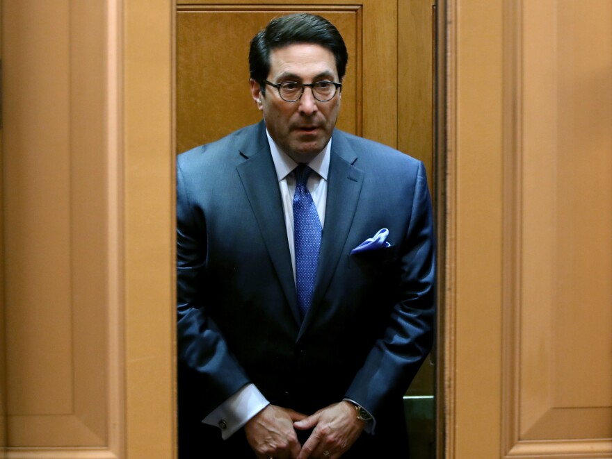 President Trump's lawyer Jay Sekulow rides an elevator to the Senate chamber for the impeachment trial Tuesday.