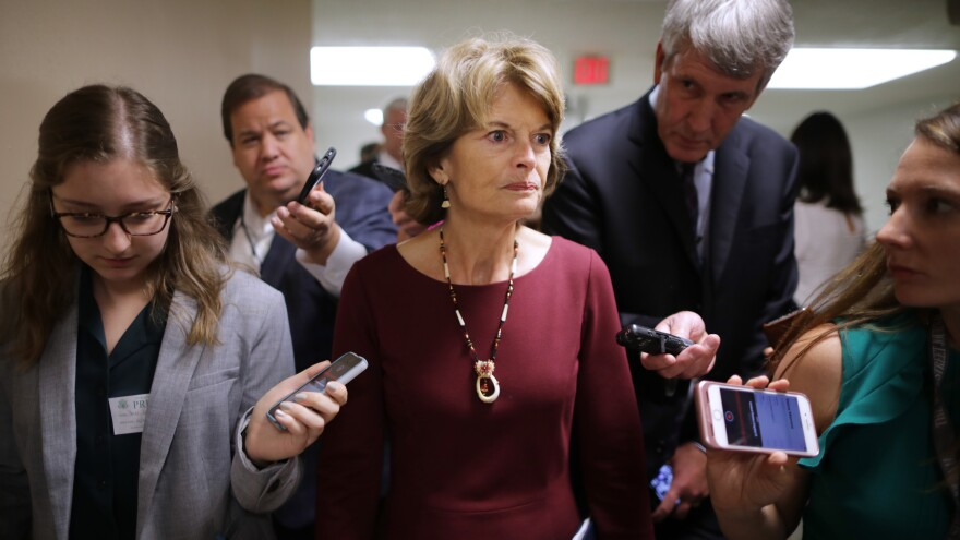Sen. Lisa Murkowski, R-Alaska, talks with reporters Tuesday as she heads for the weekly Senate Republican policy luncheon at the U.S. Capitol.