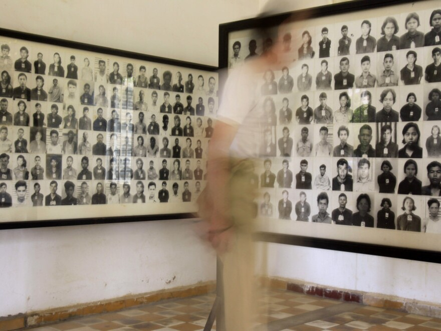 <p>A tourist views photos of former Khmer Rouge prisoners at the Tuol Sleng genocide museum, formerly the regime's notorious S-21 prison, in Phnom Penh, Cambodia, in a photo from 2009. </p>