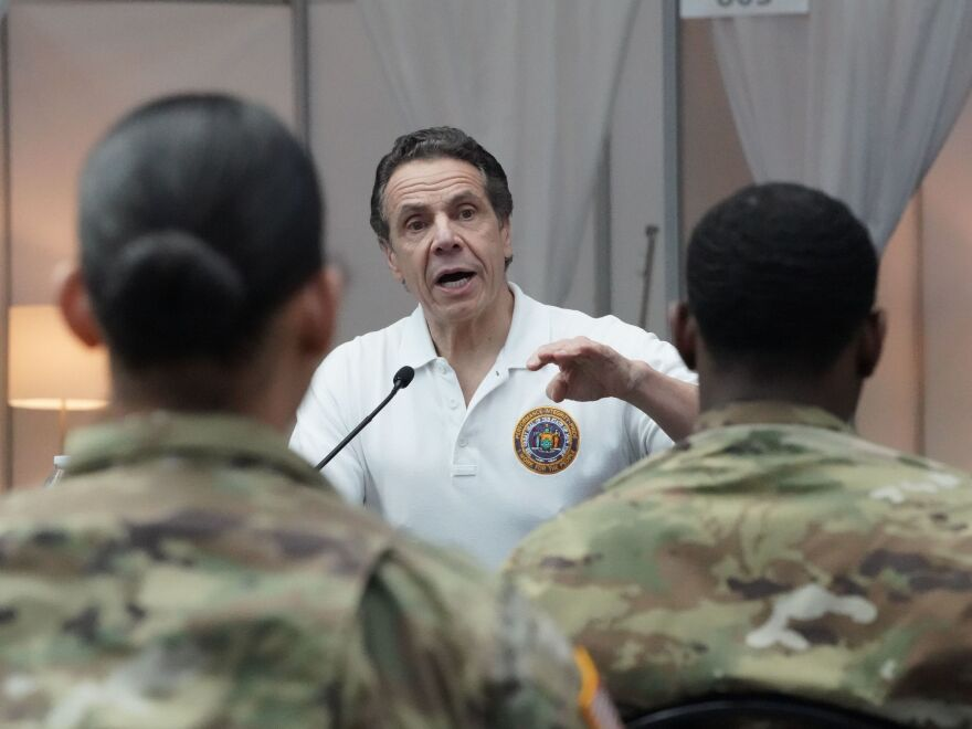 National Guard troops listen as New York Gov. Andrew Cuomo addresses a crowd on Friday at the Jacob K. Javits Convention Center in New York, which has been converted into a hospital.